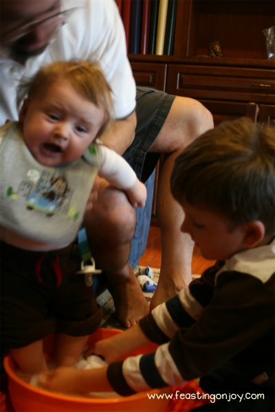 Corb washing baby C's feet Maundy Thursday